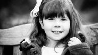 black and white portrait young girl smiling outside