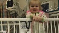 Emma in a crib