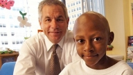 Dr Maris with a cancer patient