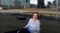 Ashley smiling outside