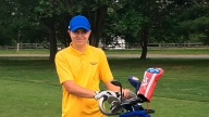 Jacob with his golf clubs