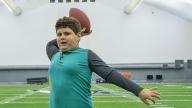 Massimo throwing a football