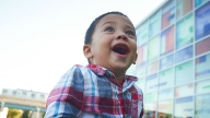 Excited young boy outside Karabots Center