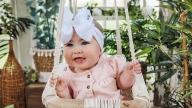 Baby Sophia sitting in a swing
