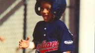 young roberto playing baseball