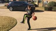 Connor playing basketball