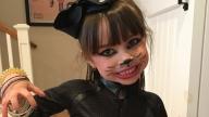 Ella smiling in a halloween costume