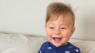 Elliot smiling sitting in bed