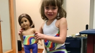 patient with doll wearing brace