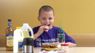 Epilepsy patient Korey eating food
