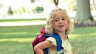 Maeve with her school backpack