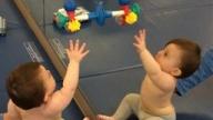 Child reaching forward