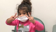 Leilani wearing a protective mask