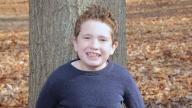 Jacob smiling outside