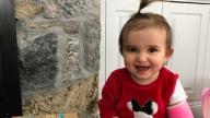 Kaylee smiling sitting on porch