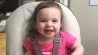 Lilly sitting in highchair and smiling