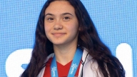 Maia wearing a gold medal