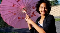 Mariah smiling standing with parasol
