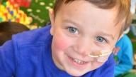 Matthew crohns disease patient smiling in playroom