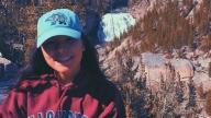 girl wearing hat in park