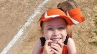 Audrey in her softball uniform