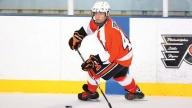 nicholas playing hockey