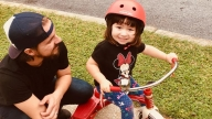 Jackie riding a tricycle