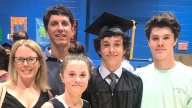 Ryan with his family at 8th grade graduation