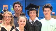 Ryan with his family at 8th grade graduation