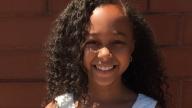 Simone smiling outside
