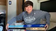 Zach displaying his baseball bats