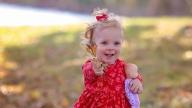 Violet holding her doll